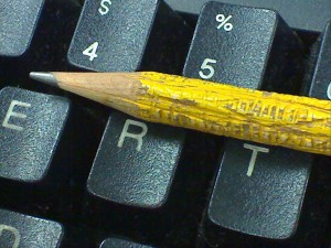 Chewed up pencil and computer keyboard.